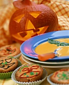 Pumpkin soup & Halloween muffins with pumpkin in background