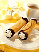 Two cannelons (wafer rolls filled with cream)