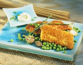 Cod fillets in cornflake panade with peas