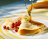 Pancakes with redcurrants and maple syrup