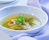 Clear spring onion soup with shrimps