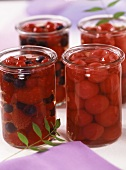 Cherries in sherry and berries in Cassis in preserving jars