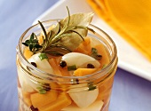 Sweet and sour bottled garlic with carrots in jar