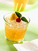 Mai Tai in glass, garnished with pineapple, mint, cherry