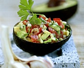 Bowl of guacamole (tomato and avocado sauce)