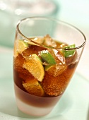 Cuba Libre with lime wedges in glass