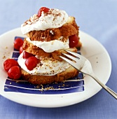 Madeira cake tower with cream, hazelnuts and cherry compote