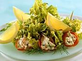 Filled salmon rolls with oak leaf lettuce
