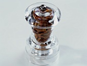Glass spice mill with dried chillies