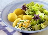 Potatoes boiled in their skins with lettuce and herb sauce