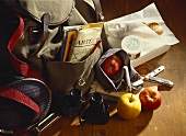 Still life with rucksack, binoculars and provisions