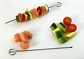 Making turkey, courgette and tomato kebabs