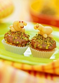 Fruit puree muffins with marzipan lambs