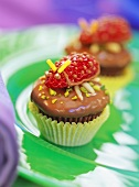 Strawberry and chocolate muffins with strawberry beetles