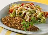 Plaice fillet with sesame panade and salad