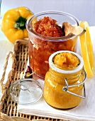 Yellow curried pepper sauce & red hot chili sauce in jars
