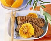 Barbecued liver with orange slices