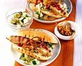 Barbecued hot dog (with sausage, gherkins & fried onions)