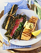 Fish in vine leaves and salmon with lemon and caper butter