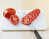 Tomatoes, some sliced