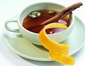 Black tea with cinnamon, cardamom and orange peel