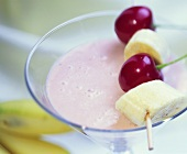 Cherry and banana shake with skewered fruit