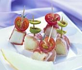 Bocconcini (melon, ham, olives, tomatoes on cocktail sticks)