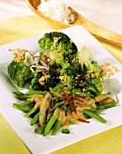 Green beans with chili strips; broccoli with coconut sauce