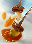 Game fondue with cabbage and rose hip sauce