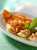 Barbecued fruit with flaked almonds