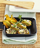Courgette flower cakes with sheep's cheese in raclette pan