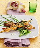 "Shrimp kebabs with herb sauce cooked on ""hot stone"""