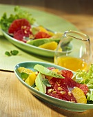 Avocado salad with citrus fruit and walnuts