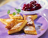 Fried semolina slices with cherries