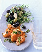Spanish carrot salad with bottled olives