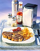 Rump steak with potato sticks; ketchup; spices