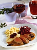 Venison Baden-Baden style with morels, red cabbage and noodles