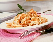 Pasta in cream sauce with walnuts