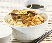 Asian noodle salad with beef; soy sauce