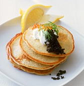 Blini with caviare and sour cream