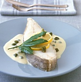 Halibut cutlet in caper sauce with lemons and bay leaf