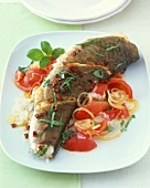 Haddock with tomatoes and onion rings