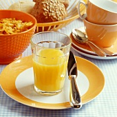 Orange juice, cornflakes and granary rolls for breakfast