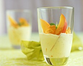 Mango yoghurt with cashew kernels and cornflakes