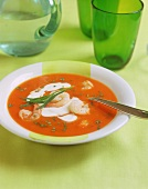 Tomato soup with shrimps and sour cream