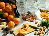 Still life with apricots, almonds, preserving jars etc.