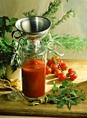 Home-made tomato ketchup; herbs; fresh tomatoes