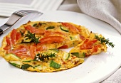 Omelette with tomatoes and courgettes