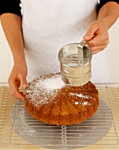 Dusting cake with icing sugar