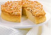 Caramelised almond cake, a piece cut
